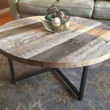 round reclaimed wood table with metal base