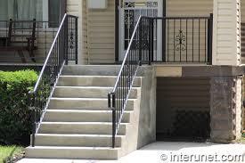 wood porch concrete steps steel railing