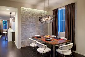 contemporary dining room with a gray stone accent wall