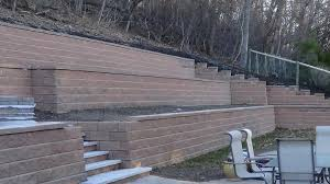 a view of the retaining wall installed by albert pinkhasov in his newton backyard without a