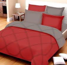 red and white hotel style bed sheets