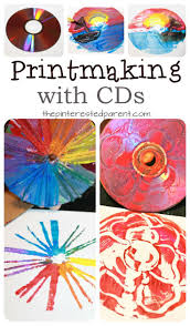 Printmaking with CDs - techniques using paint , yarn, Q-tips and paint.