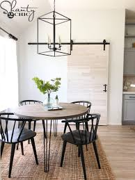 this diy barn door is easy to customize to fit any door size it s a super easy and affordable project and you don t have to remove the door trim