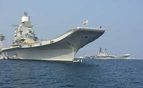 ins china india should focus on economy not aircraft carriers to counter