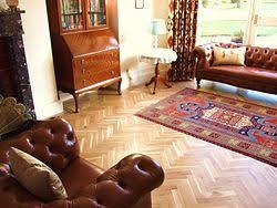 oak herringbone parquet floor with two strip wenge border