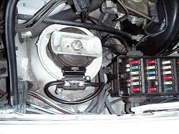 e relays fuses questions mercedes benz forum in front of the driver under the hood behind the shock tower and next door neighbors to the brake booster it ll be under a black square a shiney