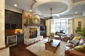 fireplace mantel with built in cabinets family room traditional with wood trim wine racks throw pillows
