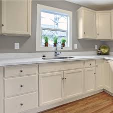 our other specialty is kitchen cabinet refinishing changing honey oak to white cream or black