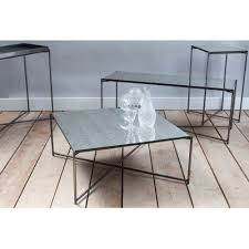 antiqued glass rectangular coffee table with metal cross base