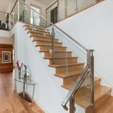 Modern Staircase With Wood Steps & Glass Railing