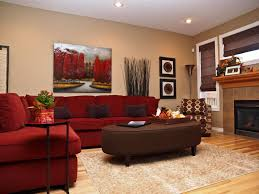 Lush red L-shaped sectional sofa wraps around this plush brown oval ottoman  in fabric