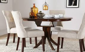 cream compact extending dining table: hudson round dark wood extending dining table and  chairs set bewley oatmeal