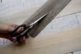 I used scissors to cut each wide strip into multiple pieces. This saved  money! I made my strips all different sizes. The thin balsa wood can easily  be cut ...