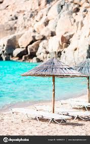 beach chairs on exotic tropical white sandy beach photo by d travnikov