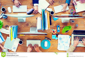 office desk work. Group Of Business People Working On An Office Desk Work T