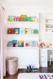 kids desk next to stacked book ledges