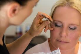 melbourne wedding photography photo of bride having her makeup done by bevy of beauties