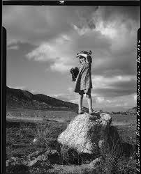Rosita Dee Cornell standing on a rock in Pigeon Pass, shielding ...