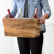 wood trough wine chiller engraved with two first names and elished date