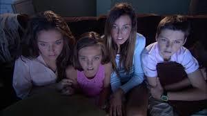 kids watching tv at night. kids watching tv at night c