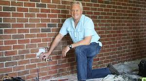 how to hang drywall over bricks today