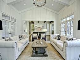 cottage living room with exposed beam cathedral ceiling chandelier carpet for hang ceiling chandelier vaulted