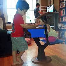 a family of standing desk users at home courtesy of sandor weisz