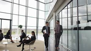 corporate office lobby. 4K Businessmen Talking As They Walk Through Lobby Of Corporate Office Building (UK-Oct 2016) Stock Footage Video 21771874 | Shutterstock S