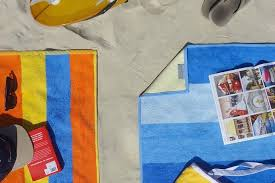 beach towels on sand. Finally, A Beach Towel That Leaves The Sand At Beach. Whoo! Towels On