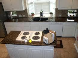brown backsplash brown granite with white cabinets brown with white cabinets and white appliance brown glass tile kitchen backsplash brown glass backsplash