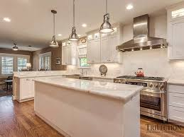 kitchen s new look with pure white quarzite countertop after trifection made the upgrade