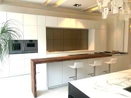 Kitchen islands with breakfast bar Winduprocketapps Ex Display Warendorf Opaque White Kitchen Island Breakfast Bar Corian Worktops And Gaggenau Appliances The Used Kitchen Company The Used Kitchen Company Ex Display Warendorf Opaque White Kitchen Island Breakfast Bar