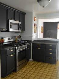 dark gray cabinets small corner kitchen ideas gas range and vent hood brown latte tile flooring