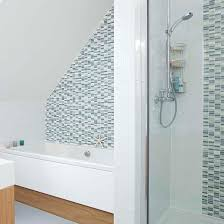 shower cabin with chic monochrome tiles tile decorated with pattern is a trend in the design of small bathrooms so choose a small part of the wall