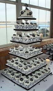 Black And White Wedding Cake With Cupcakes