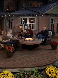 ravishing patio furniture round propane fire pit table beige stone top bronze wicker conversation set brown cushion deck design ideas outdoor tabletop