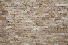 how to grout travertine tile on a wall