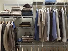 organized closet shelving with neatly folded clothes