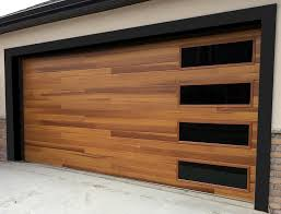 wood garage door. accent planks on this c.h.i. cedar door make it a strong statement piece, but the. garage styleswood wood t