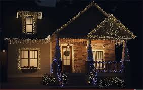 outdoor christmas lighting. beauty shot of home lit with christmas lights at night outdoor lighting
