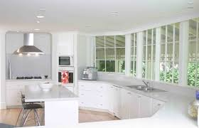 White Kitchens With White Granite Countertops Wooden Backless Bar Stools Light Wood Flooring Cream Solid
