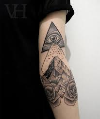 Wonderful Triangle Eye With Mountains And Roses Tattoo On Tricep By
