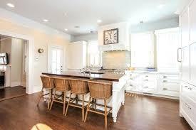 shaker kitchen cabinets white traditional kitchen with white cabinets butcher block island white shaker cabinet kitchen