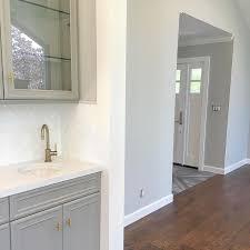 white bathroom cabinets gray walls. {walls are sw repose gray and cabinets dovetail} white bathroom walls e