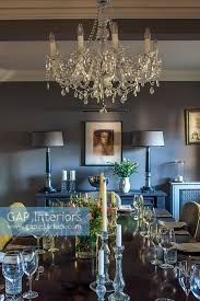 chandelier by india jane above dining table