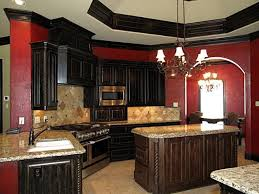 Love the red kitchen and dark wood. Maybe only one red wall and accents