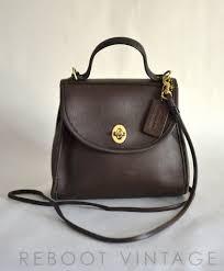 Vintage COACH Small Brown Leather Turnlock Crossbody Bag.  75.00, via Etsy.  Nyc Fashion