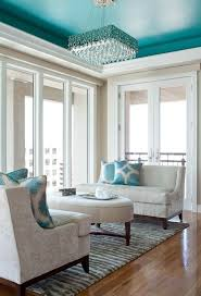 charming teal ceiling with a gorgeous accenting chandelier get the look with dunn