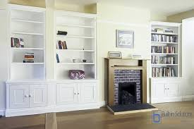 featuring wide strong a run of traditional alcove cupboards in all the alcoves in the room