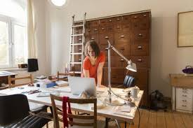 a home office. A Young Female Designer Working In Home Office